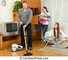 girl helping happy parents to clean - Happy smiling girl ...