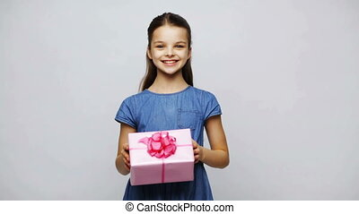 happy smiling girl holding gift box - childhood, people,...