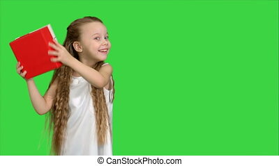 Happy smiling girl holding gift box on a Green Screen,...