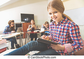 Happy smiling girl in classroom