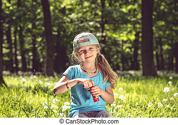happy smiling girl in forest