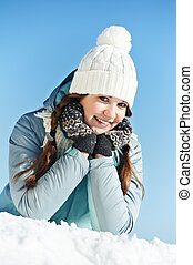 happy smiling girl in snow winter outdoors