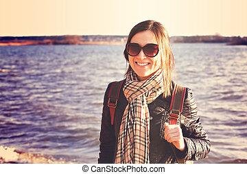 Happy smiling girl on the seaside