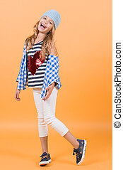 Happy smiling girl wear shirt with red heart