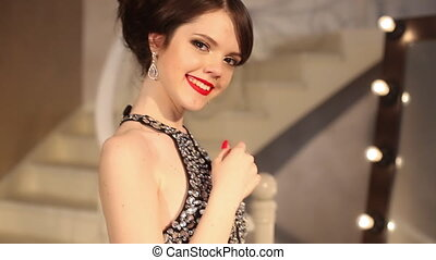 Happy smiling girl with makeup and hairstyle, red manicure ...