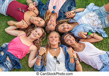 happy smiling group of diverse girls at summer camp