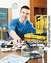 Happy smiling guy showing toolbox