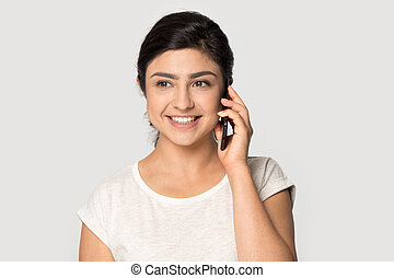Happy smiling indian woman talking on mobile phone.