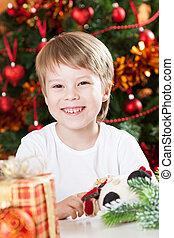 Happy smiling kid in Christmas