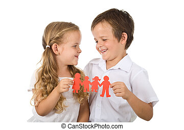 Happy smiling kids holding paper people - isolated