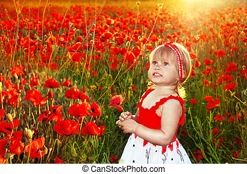 Happy smiling little fun girl in red poppies field, sunset outdoors portrait