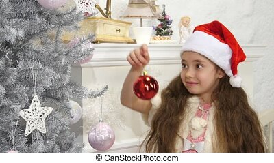 happy smiling little girl decorated new year tree red ball