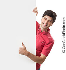 happy smiling man holds a blank board and shows thumbs up
