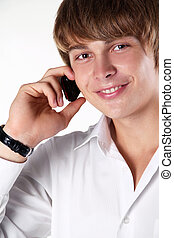 Happy smiling man  talking on mobile phone