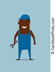 Happy smiling mechanic or repairman with wrench