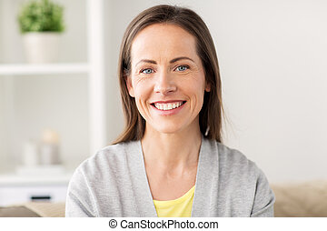 happy smiling middle aged woman at home