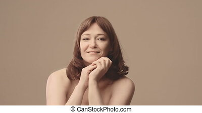 Happy, smiling middle aged woman Brown-haired. Natural.. High quality 4k footage