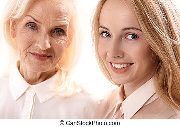 Happy smiling mom and daughter - Joyful young woman is...