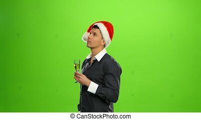 Happy smiling new years eve celebrating man with hat on party. green screen
