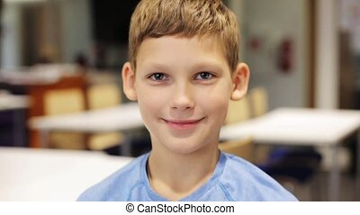 happy smiling preteen boy at school