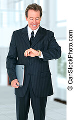 Happy Smiling Senior Businessman Checking Time