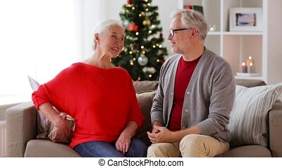 happy smiling senior couple with christmas gift - christmas,...