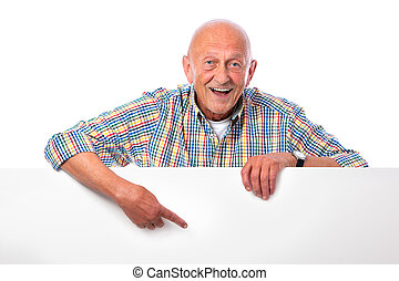 happy smiling senior man holds a blank board