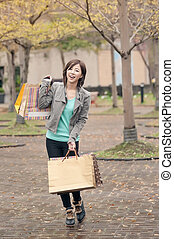 Happy smiling shopping woman