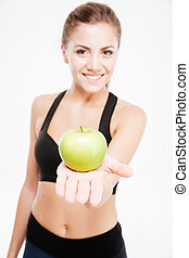 Happy smiling sports woman showing lettuce and green apple ...
