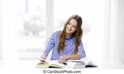 happy smiling student girl with books