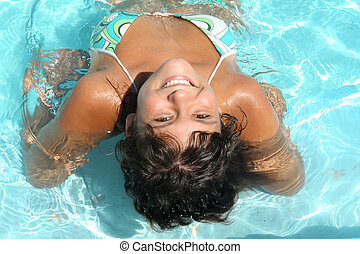happy smiling, tanned young woman on summer vacation