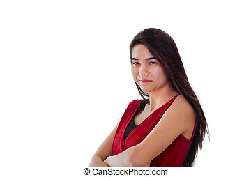 Happy smiling teen girl in red dress, arms crossed