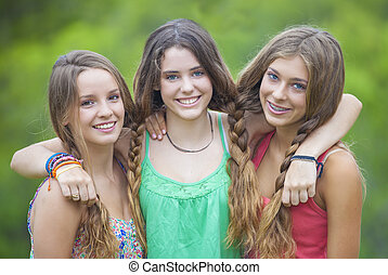 happy smiling teenage girls with white teeth
