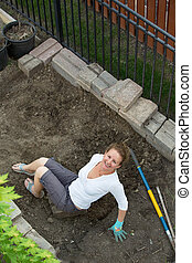 Happy smiling woman doing yard maintenance
