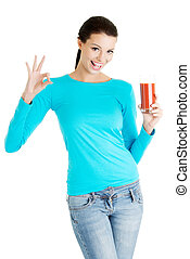 Happy smiling woman drinking tomato juice
