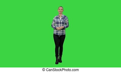 Happy smiling woman in casual presenting and showing something on a Green Screen, Chroma Key.