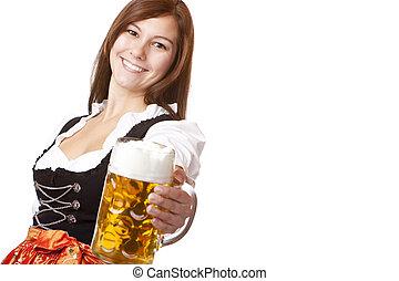 Happy smiling woman in dirndl dress holding Oktoberfest beer...