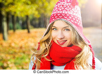 Happy Smiling Woman in Hat on Autumn Background