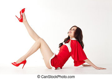 happy smiling woman in red xmas sexy costume on white background