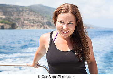 Happy smiling woman in sea cruise on ship