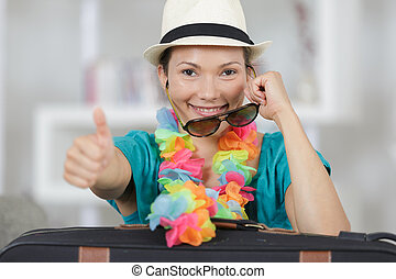 happy smiling woman in sunglasses at home