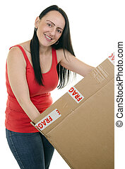 smiling woman opening a parcel