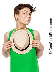 Happy smiling woman posing in a studio with a hat
