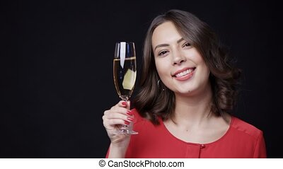 Happy smiling woman with glass of champagne