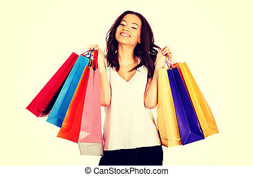 Happy smiling woman with shopping bags.
