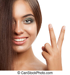 Happy smiling woman with straightened hair.