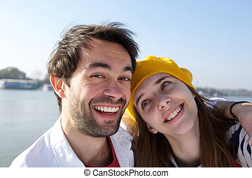 Happy smiling young couple laughing