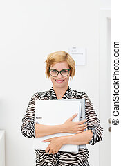 Happy smiling young female office worker