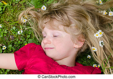 happy smiling young girl in grass