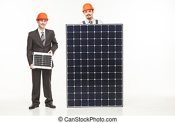 Happy smiling young men solar panel